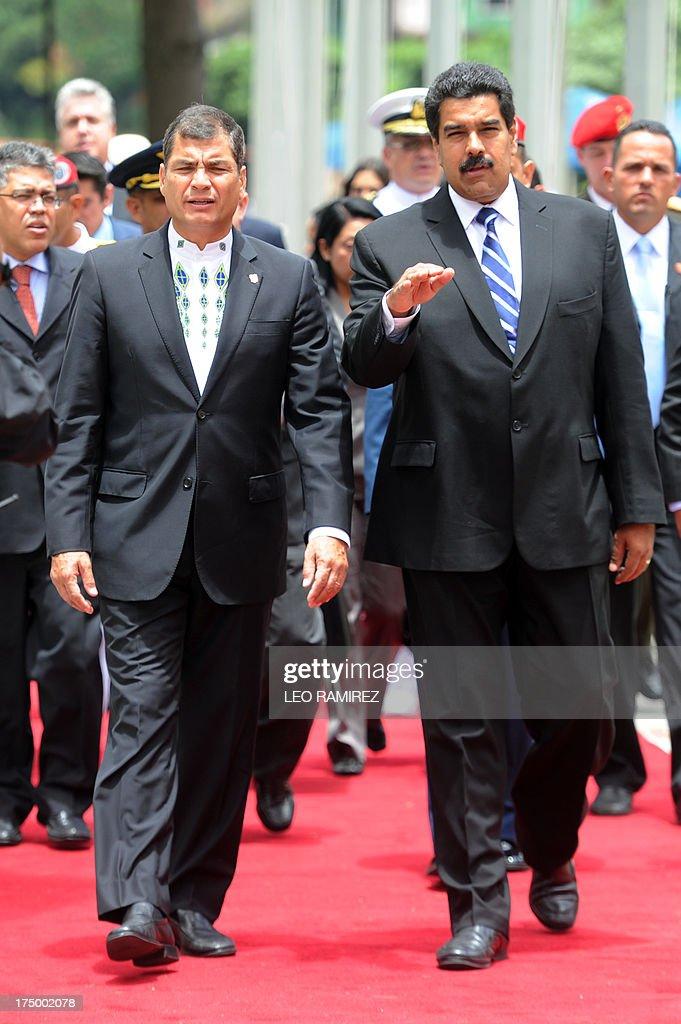 Venezuelan President Nicolas Maduro (R) and Ecuadorean President Rafael Correa arrive at the Cuartel de la Montana to pay tribute to late president Hugo Chavez, on July 29, 2013 in Caracas. Correa visits Venezuela to strengthen bilateral cooperation projects with Nicolas Maduro's government, five months ago Hugo Chavez's death. AFP PHOTO/Leo RAMIREZ