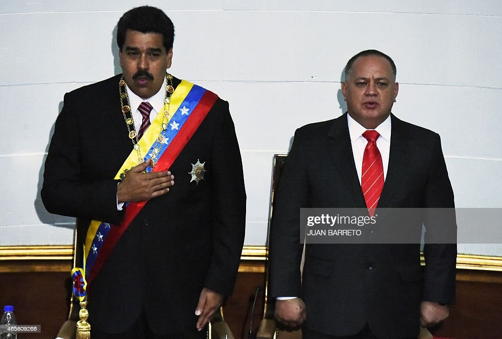 Venezuelan President Nicolas Maduro (L) and the president of the National Assembly, <a gi-track='captionPersonalityLinkClicked' href=/galleries/search?phrase=Diosdado+Cabello&family=editorial&specificpeople=3799005 ng-click='$event.stopPropagation()'>Diosdado Cabello</a>, listen to the national anthem after submitting the powers request during a session of the National Assembly in Caracas, on March 10, 2015. Maduro requested special decree powers to confront what he termed 'imperialist aggressions' from the United States, as relations between the countries sank further. AFP PHOTO/JUAN BARRETO
