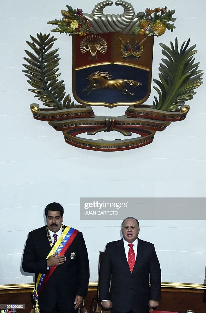 Venezuelan President Nicolas Maduro (L) and the president of the National Assembly, <a gi-track='captionPersonalityLinkClicked' href=/galleries/search?phrase=Diosdado+Cabello&family=editorial&specificpeople=3799005 ng-click='$event.stopPropagation()'>Diosdado Cabello</a>, listen to the national anthem after submitting the powers request during a session of the National Assembly in Caracas, on March 10, 2015. Maduro requested special decree powers to confront what he termed 'imperialist aggressions' from the United States, as relations between the countries sank further.