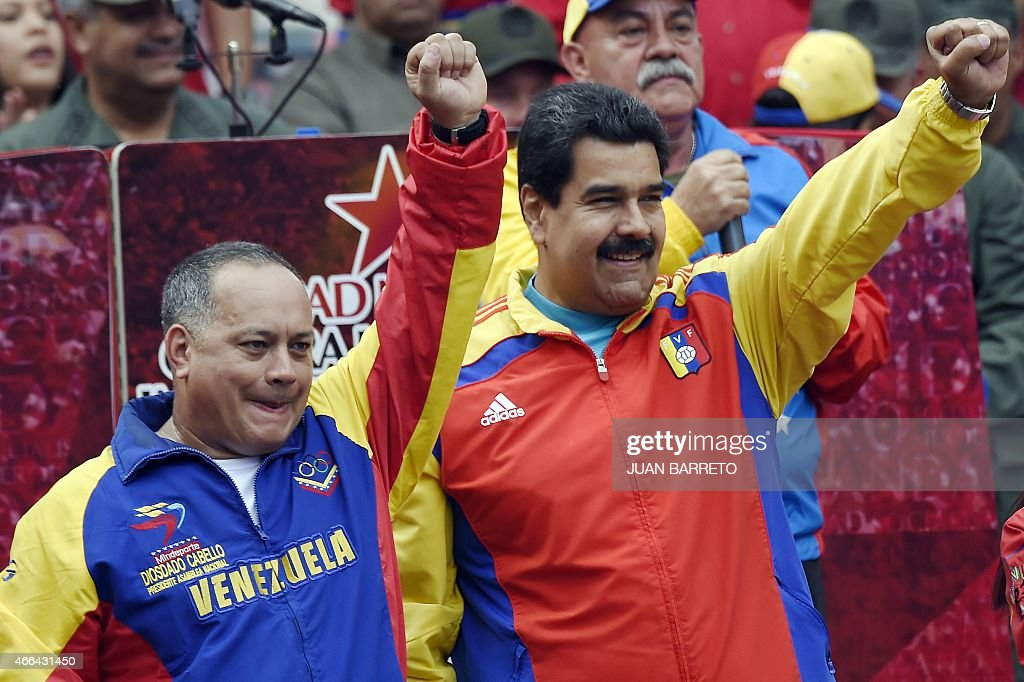 Venezuelan President Nicolas Maduro (R) and the president of the National Assembly, <a gi-track='captionPersonalityLinkClicked' href=/galleries/search?phrase=Diosdado+Cabello&family=editorial&specificpeople=3799005 ng-click='$event.stopPropagation()'>Diosdado Cabello</a> salute after receiving the decree powers law, in Caracas on March 15, 2015. Venezuela's National Assembly voted Sunday to give President Nicholas Maduro decree-making powers in defense and security affairs amid an escalating confrontation with Washington. The special powers were approved by a show of hands in the assembly after two hours of debate and will be in effect for six months.