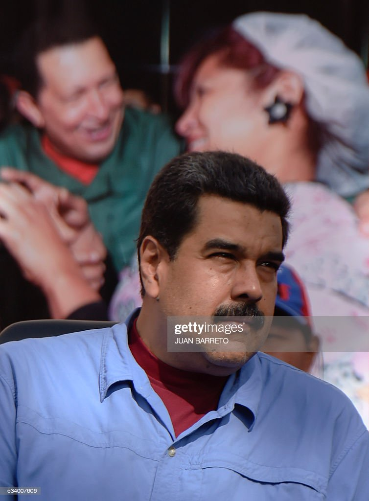 Venezuelan President Nicolas Maduro attends a rally with women in Caracas on May 24, 2016. / AFP / JUAN