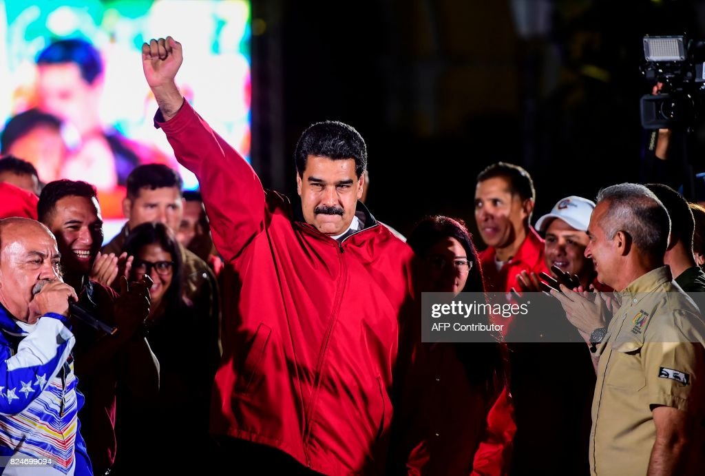 TOPSHOT - Venezuelan president Nicolas Maduro celebrates the results of 'Constituent Assembly', in Caracas, on July 31, 2017. Deadly violence erupted around the controversial vote, with a candidate to the all-powerful body being elected shot dead and troops firing weapons to clear protesters in Caracas and elsewhere. /
