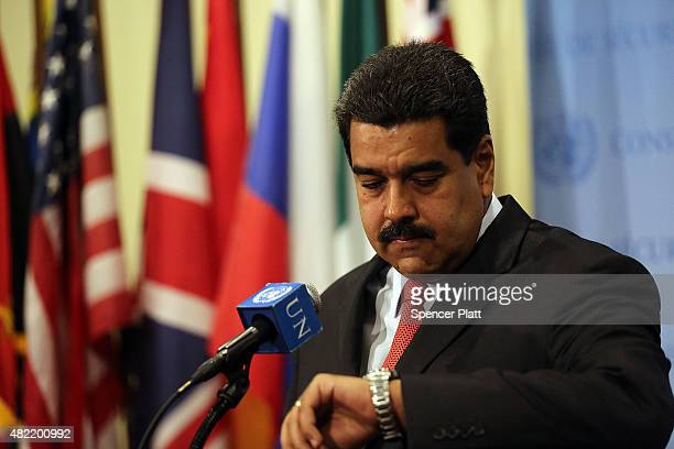Venezuelan President Nicolas Maduro checks his watch as he speaks to the media following a meeting with UN chief Ban Kimoon at the United Nations...