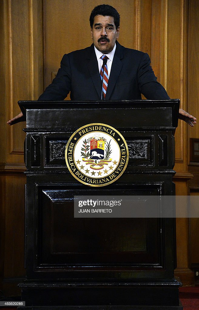 Venezuelan President Nicolas Maduro delivers a speech after receiving from the National Assembly the new law 'Plan de la Patria'--presented by the late president Hugo Chavez during the 2012 presidential campaign-- at the Miraflores presidential palace, in Caracas on December 4, 2013.