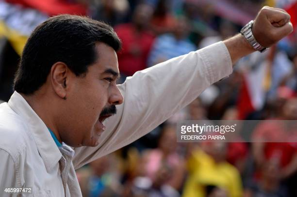 Venezuelan President Nicolas Maduro delivers a speech before supporters gathering outside the presidential palace in Caracas on March 12 2015 The...