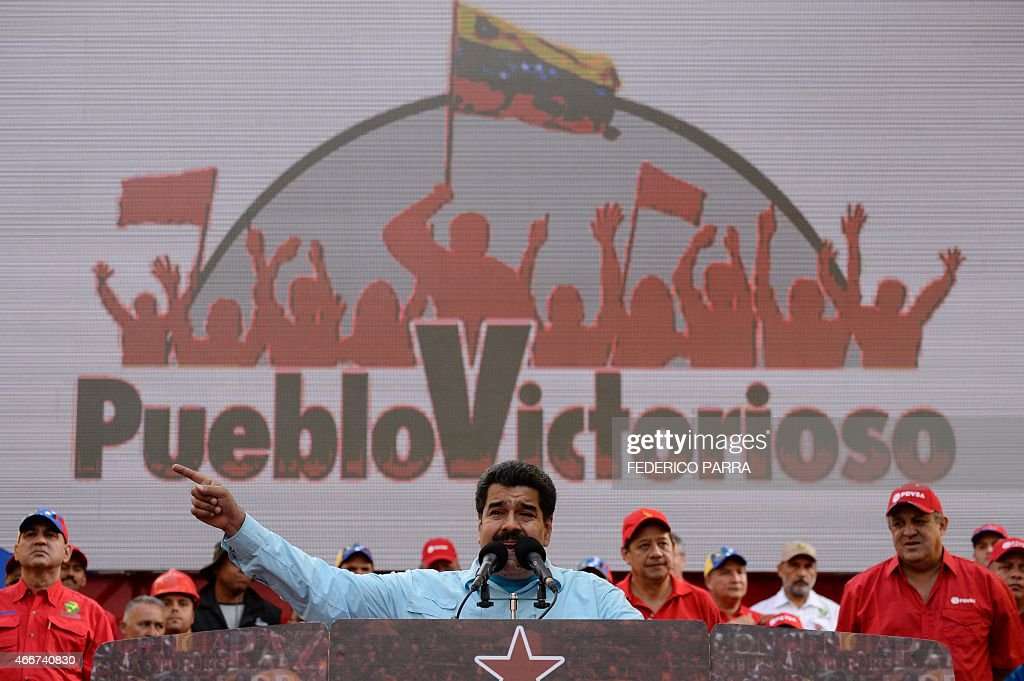 Venezuelan President Nicolas Maduro delivers a speech before supporters gathering outside the presidential palace in Caracas on March 18, 2015. Leaders from leftist Latin American regional bloc ALBA gathered Tuesday for a summit in Caracas, a show of support for Venezuela in its mounting standoff with the United States. AFP PHOTO/FEDERICO PARRA