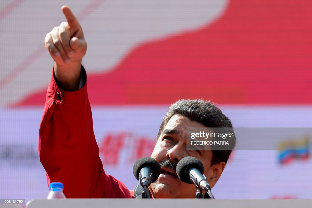 Venezuelan President Nicolas Maduro delivers a speech during a ceremony to commemorate the 24th anniversary of former Venezuelan President Hugo...