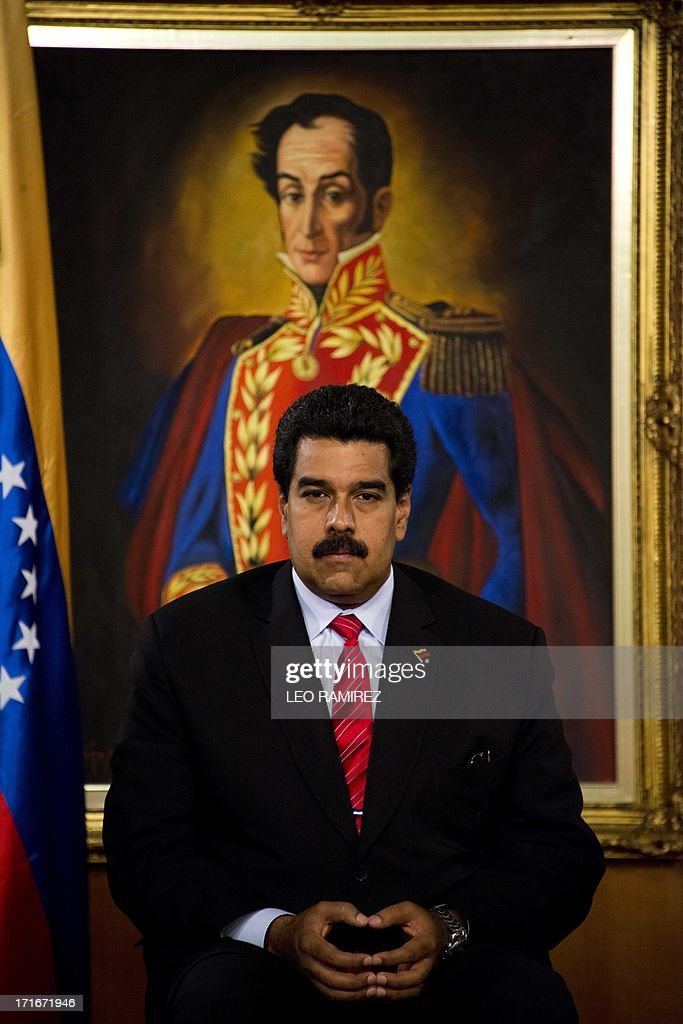 Venezuelan President Nicolas Maduro during the ceremony to posthumously grant former President Hugo Chavez the National Journalism award, at the Miraflores presidential palace in Caracas on June 27, 2013. AFP PHOTO/Leo RAMIREZ