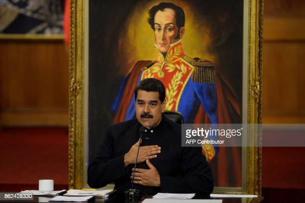 Venezuelan President Nicolas Maduro gestures during a press conference with international media correspondents at the Miraflores Presidential Palace...