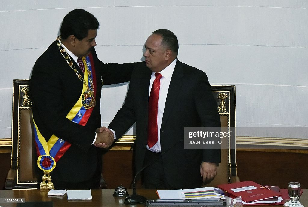 Venezuelan President Nicolas Maduro (L) greets the president of the National Assembly, <a gi-track='captionPersonalityLinkClicked' href=/galleries/search?phrase=Diosdado+Cabello&family=editorial&specificpeople=3799005 ng-click='$event.stopPropagation()'>Diosdado Cabello</a>,after submitting the powers request during a session of the National Assembly in Caracas, on March 10, 2015. Maduro requested special decree powers to confront what he termed 'imperialist aggressions' from the United States, as relations between the countries sank further. AFP PHOTO/JUAN BARRETO