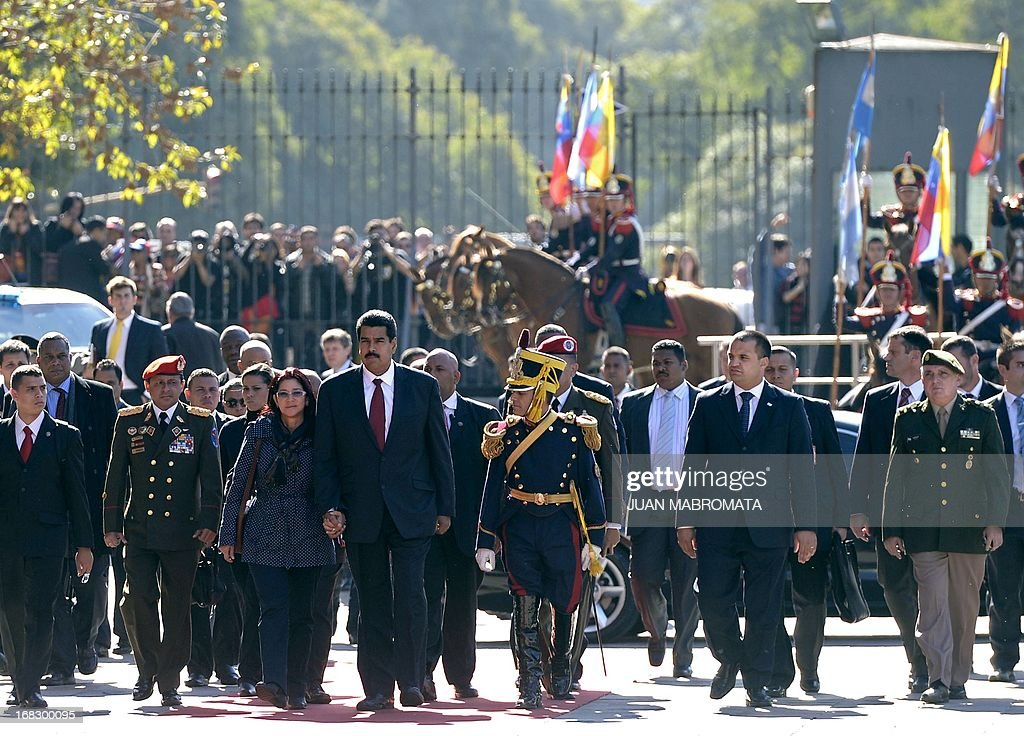 Venezuelan President Nicolas Maduro (4th-L) his wife Cilia Flores (3rd-L) arrive at the Government Palace in Buenos Aires on May 8, 2013. Maduro arrived today from Uruguay and afterwards will travel to Brazil. AFP PHOTO / Juan Mabromata