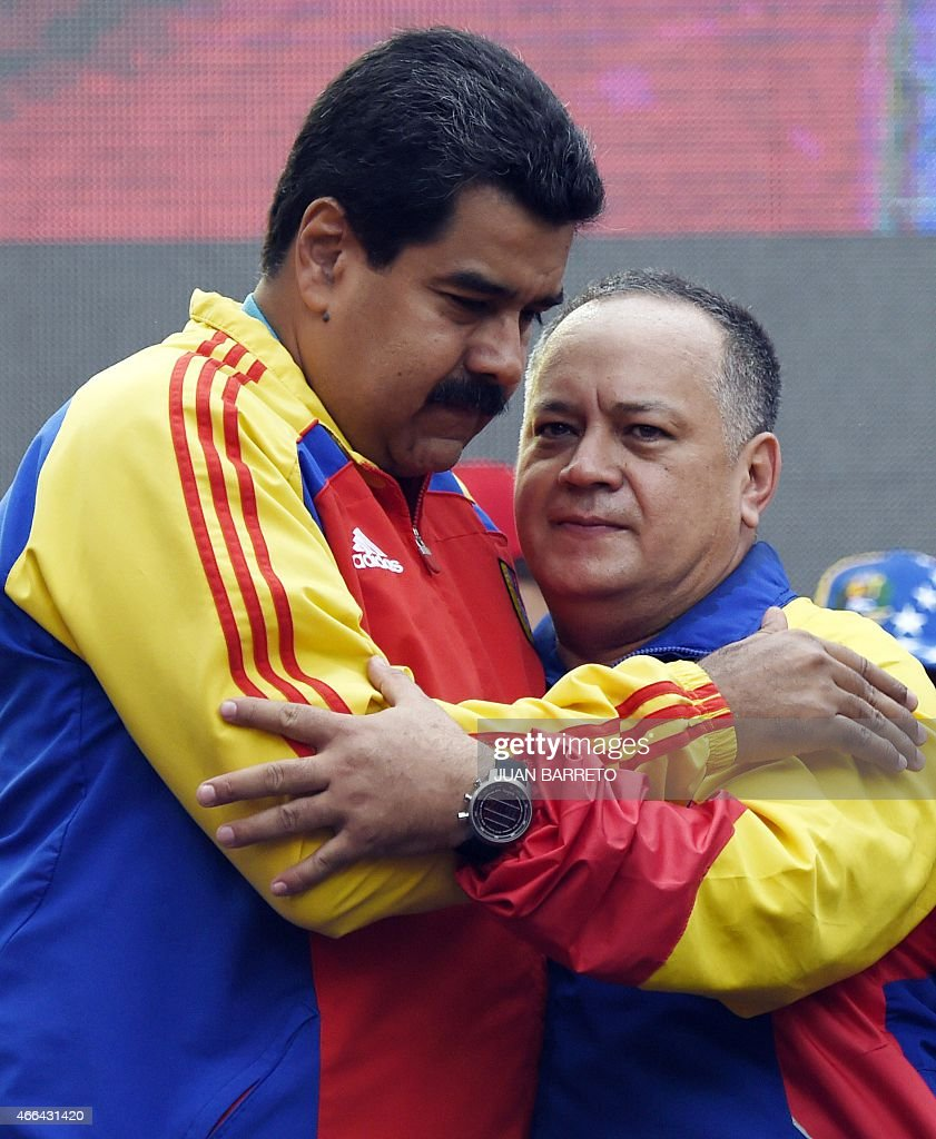 Venezuelan President Nicolas Maduro (L) hugs the president of the National Assembly, <a gi-track='captionPersonalityLinkClicked' href=/galleries/search?phrase=Diosdado+Cabello&family=editorial&specificpeople=3799005 ng-click='$event.stopPropagation()'>Diosdado Cabello</a> (R) after receiving the decree powers law, in Caracas on March 15, 2015. Venezuela's National Assembly voted Sunday to give President Nicholas Maduro decree-making powers in defense and security affairs amid an escalating confrontation with Washington. The special powers were approved by a show of hands in the assembly after two hours of debate and will be in effect for six months.