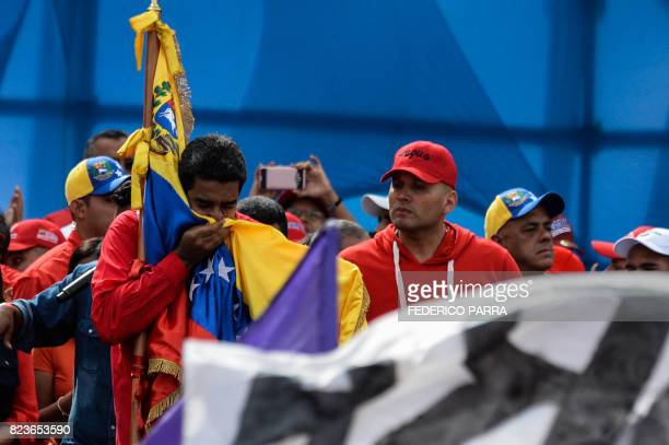 Venezuelan President Nicolas Maduro kisses a national flag during the closing of the campaign to elect a Constituent Assembly that would rewrite the...