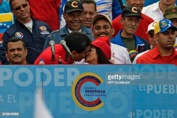 Venezuelan President Nicolas Maduro kisses First Lady and candidate for a Constituent Assembly Cilia Flores during the closing of the campaign to...