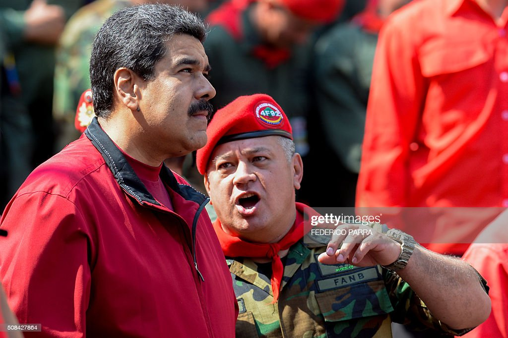 Venezuelan President Nicolas Maduro listens to deputy and former president of the National Assembly Diosdado Cabello during a ceremony to commemorate...