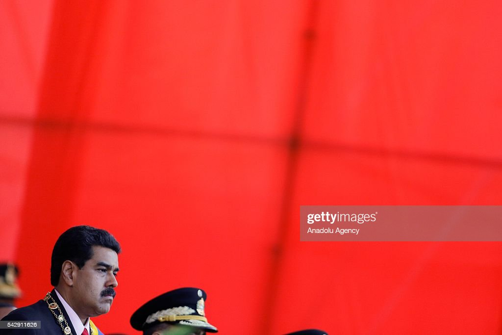 Venezuelan President Nicolas Maduro (L) pay tribute to Venezuelan hero Pedro Camejo known as Negro Primero or 'The First Black' who was killed in the battle of Carabobo at 1821, in Caracas, Venezuela on June 24, 2016.