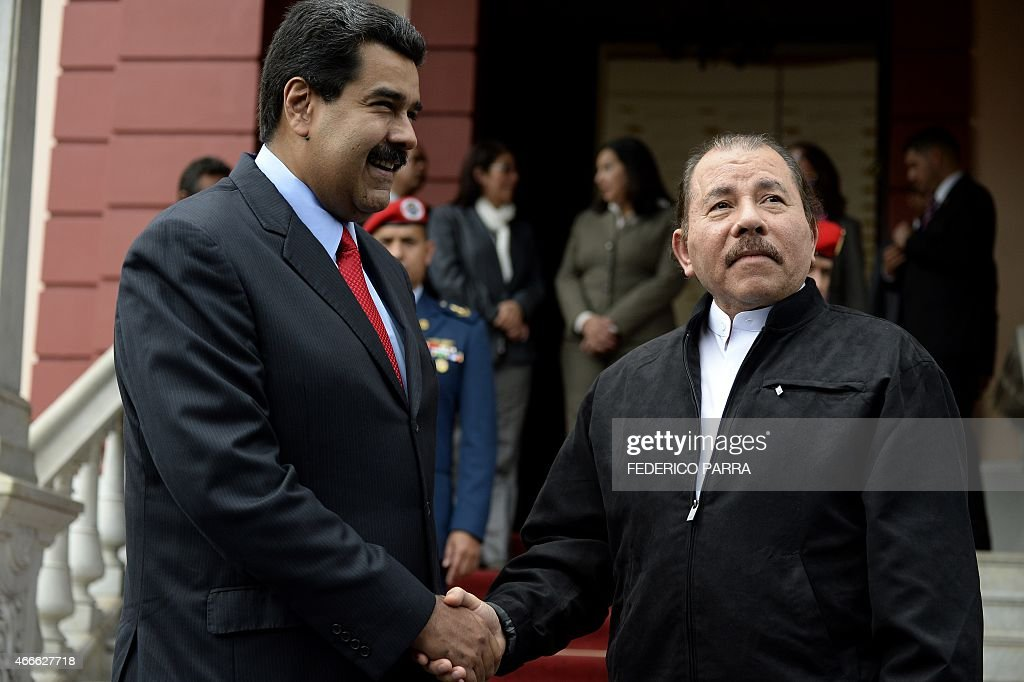 Venezuelan President Nicolas Maduro (L) shakes hands with Nicaraguan President Daniel Ortega during the ALBA Summit at the Miraflores Palace, in Caracas on March 17, 2015. Leaders from leftist Latin American regional bloc ALBA gathered Tuesday for a summit in Caracas, a show of support for Venezuela in its mounting standoff with the United States.