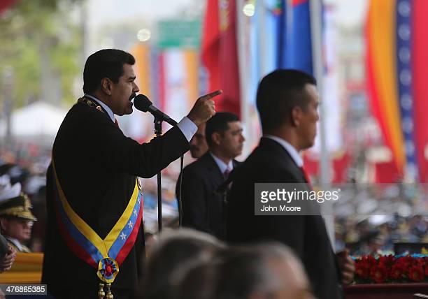 Venezuelan President Nicolas Maduro speaks before a parade marking the first anniversary of Hugo Chavez's death on March 5 2014 in Caracas Venezuela...