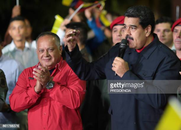 Venezuelan President Nicolas Maduro speaks beside Diosdado Cabello a member of the Constituent Assembly in Caracas on October 15 after Maduro's...