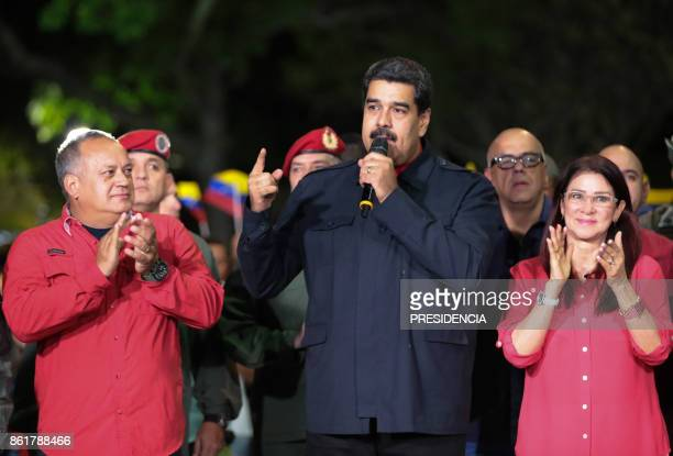 Venezuelan President Nicolas Maduro speaks beside First lady Cilia Flores and Diosdado Cabello a member of the Constituent Assembly in Caracas on...