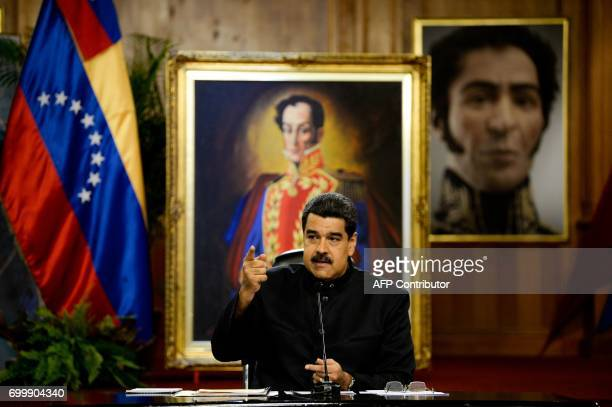Venezuelan President Nicolas Maduro speaks during a press conference for foreign correspondents at the Miraflores presidential palace in Caracas on...