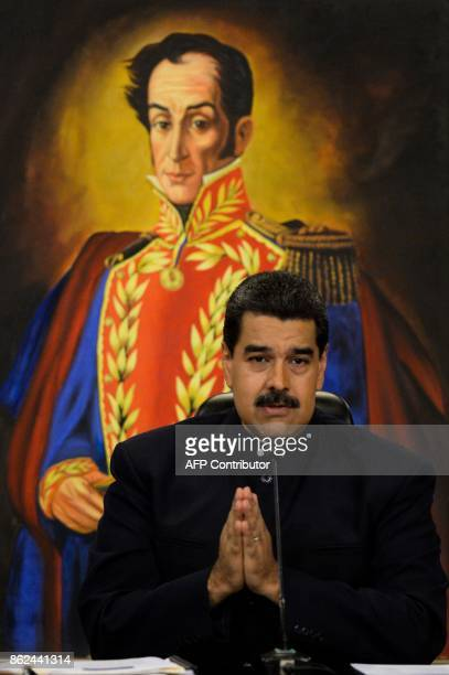 Venezuelan President Nicolas Maduro speaks during a press conference with international media correspondents at Miraflores Presidential Palace in...