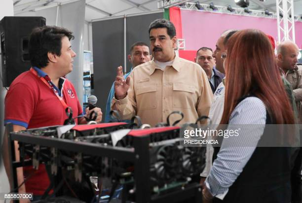 Venezuelan President Nicolas Maduro speaks in front of a computer used to mine crypto currency Ethereum at the International Science and Technology...
