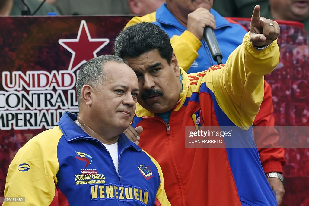 Venezuelan President Nicolas Maduro (R) speaks with the president of the National Assembly, <a gi-track='captionPersonalityLinkClicked' href=/galleries/search?phrase=Diosdado+Cabello&family=editorial&specificpeople=3799005 ng-click='$event.stopPropagation()'>Diosdado Cabello</a> after receiving the decree powers law, in Caracas on March 15, 2015. Venezuela's National Assembly voted Sunday to give President Nicholas Maduro decree-making powers in defense and security affairs amid an escalating confrontation with Washington. The special powers were approved by a show of hands in the assembly after two hours of debate and will be in effect for six months.