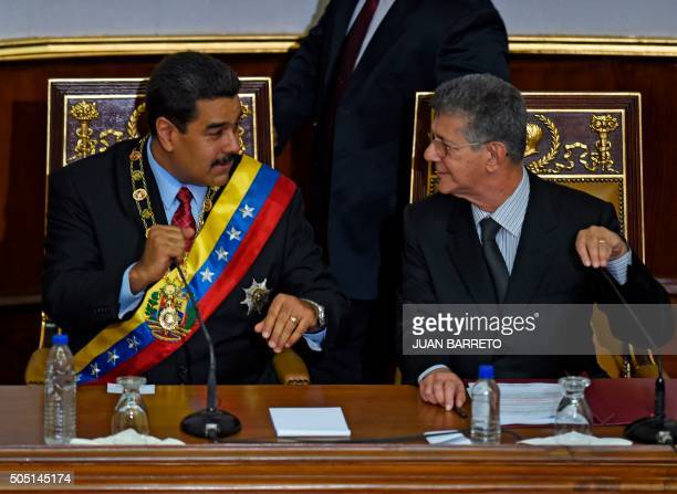 Venezuelan President Nicolas Maduro speaks with the president of the opposition controlled National Assembly Henry Ramos Allup during his annual...