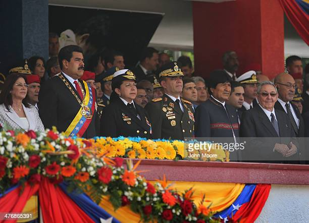 Venezuelan President Nicolas Maduro stands with his military chiefs and honored guests Bolivian President Evo Morales and Cuban President Raul Castro...