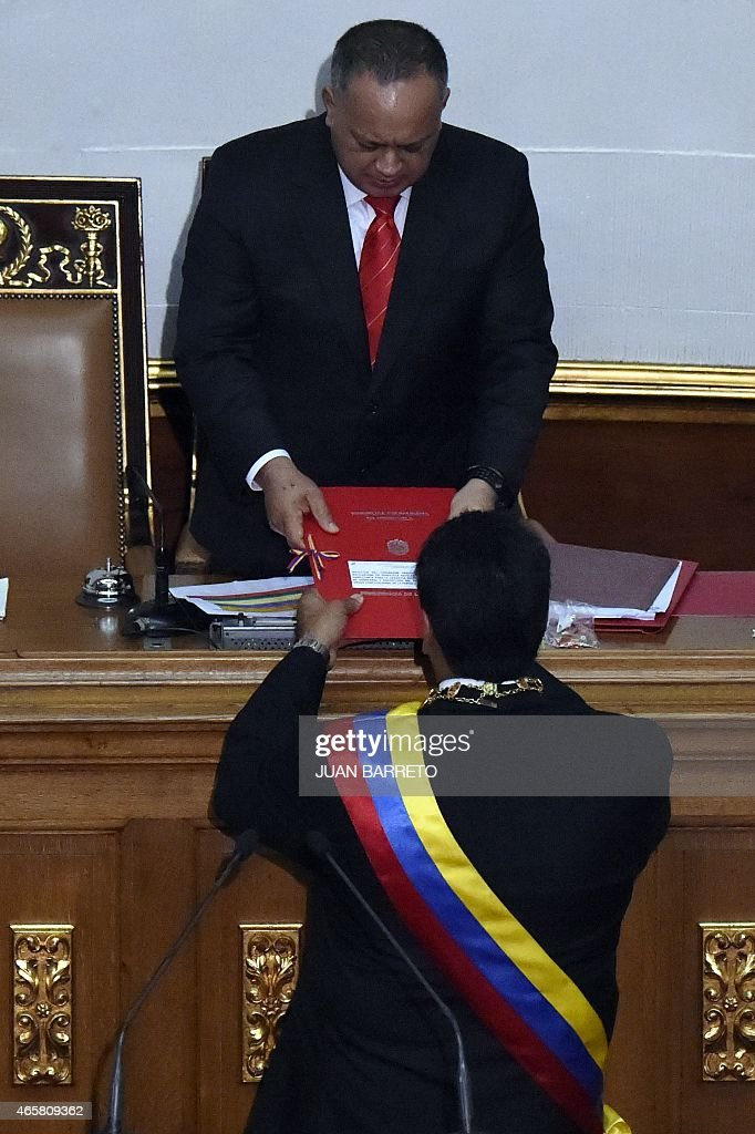 Venezuelan President Nicolas Maduro (front) submits the powers request before the president of the National Assembly, <a gi-track='captionPersonalityLinkClicked' href=/galleries/search?phrase=Diosdado+Cabello&family=editorial&specificpeople=3799005 ng-click='$event.stopPropagation()'>Diosdado Cabello</a>, during a session of the National Assembly in Caracas, on March 10, 2015. Maduro requested special decree powers to confront what he termed 'imperialist aggressions' from the United States, as relations between the countries sank further. AFP PHOTO