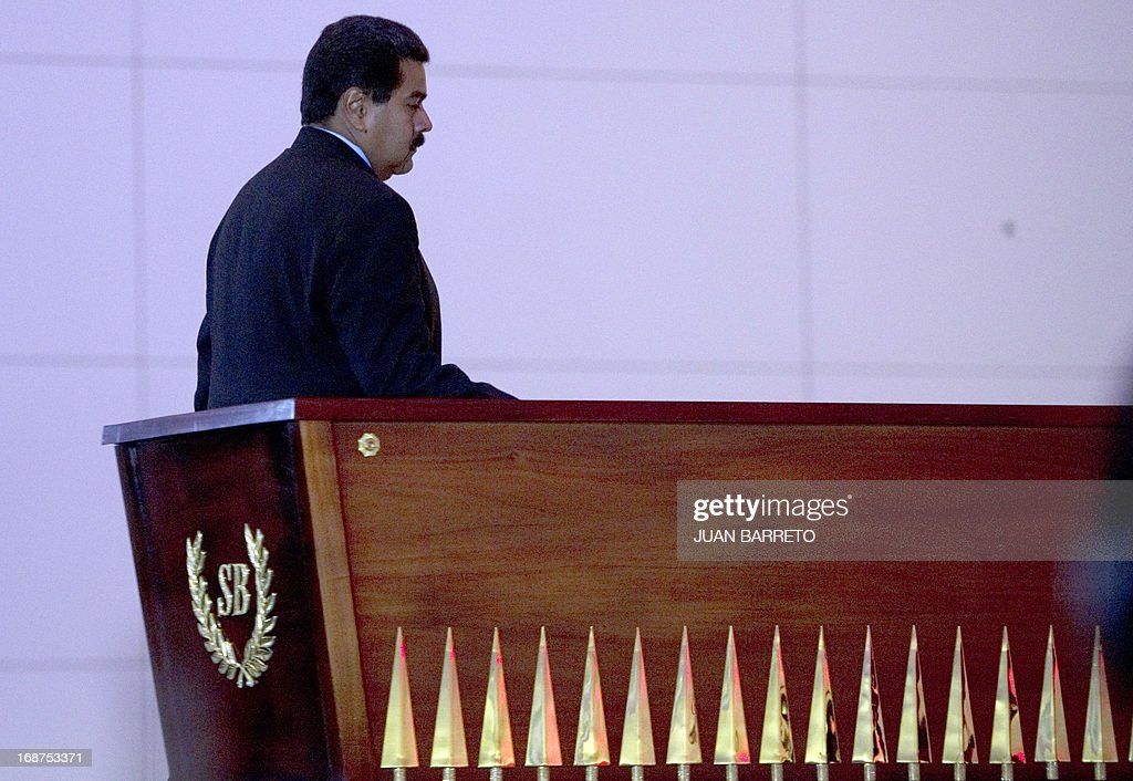 Venezuelan President Nicolas Maduro walks in front the coffin of Liberator Simon Bolivar during ceremony of the new mausoleum that will host the remains of national hero Simon Bolivar, in Caracas on May 14, 2013. The President of Venezuela, Nicolás Maduro, opened Tuesday in Caracas the mausoleum that will house the remains of the Liberator Simón Bolívar, an imposing monument created in 2010 by the deceased Hugo Chávez. AFP PHOTO
