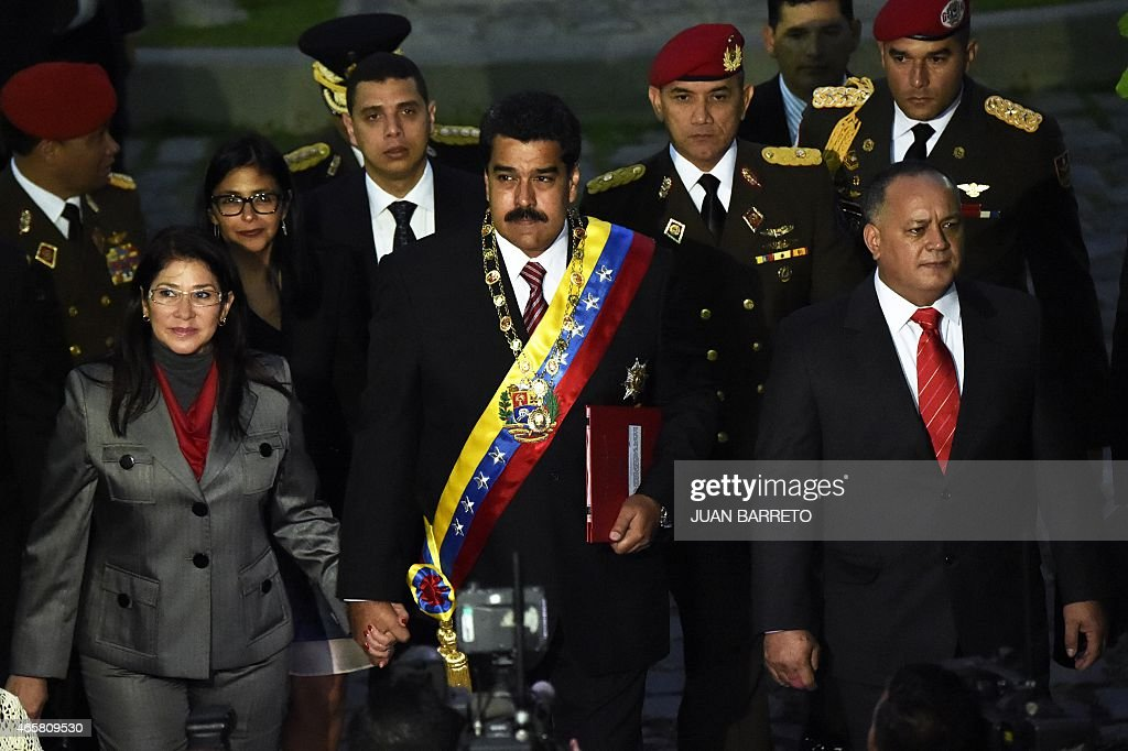 Venezuelan President Nicolas Maduro (C) walks with First Lady Cilia Flores (L) and Venezuelan President of the National Assembly, <a gi-track='captionPersonalityLinkClicked' href=/galleries/search?phrase=Diosdado+Cabello&family=editorial&specificpeople=3799005 ng-click='$event.stopPropagation()'>Diosdado Cabello</a> (R) before a session of the National Assembly in Caracas, on March 10, 2015. Venezuelan President Nicolas Maduro will request special decree powers to confront what he termed 'imperialist aggressions' from the United States, as relations between the countries sank further. AFP PHOTO / JUAN