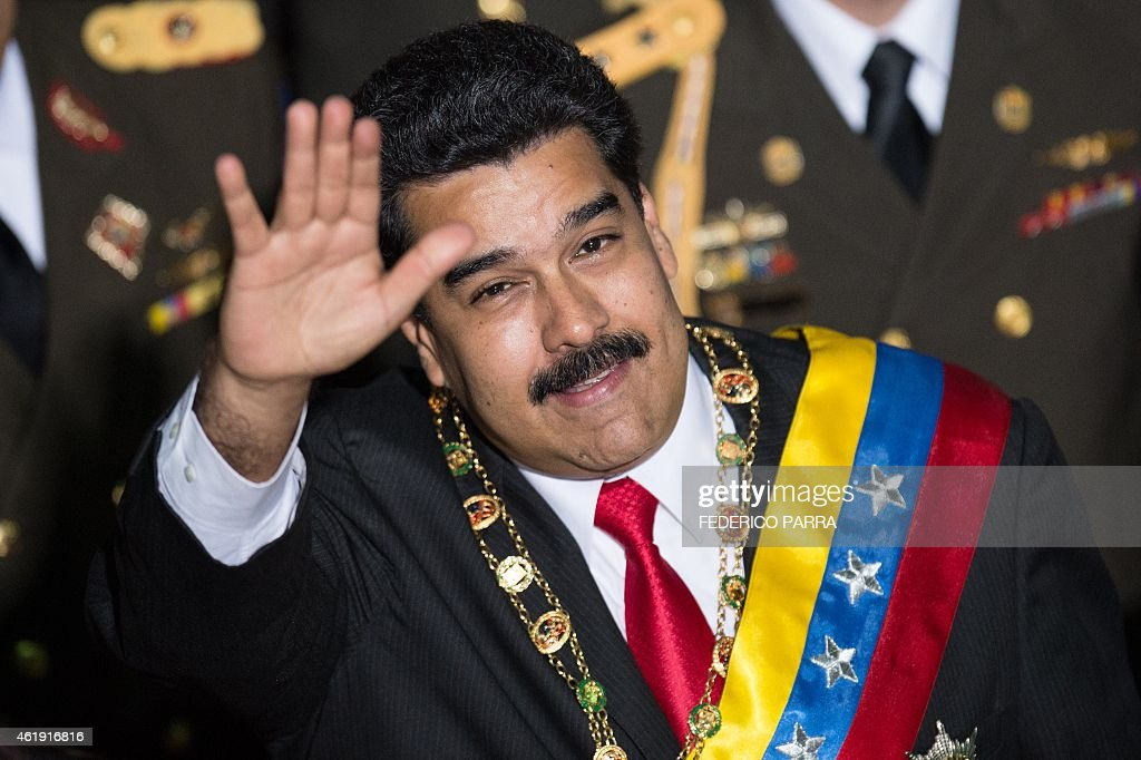Venezuelan President Nicolas Maduro waves before delivering his annual message to the Nation in Caracas on January 21, 2015.