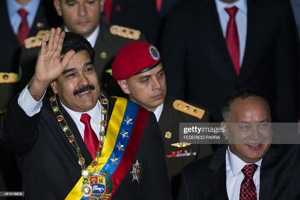 Venezuelan President Nicolas Maduro (L) waves next to the president of the Venezuelan parliament, <a gi-track='captionPersonalityLinkClicked' href=/galleries/search?phrase=Diosdado+Cabello&family=editorial&specificpeople=3799005 ng-click='$event.stopPropagation()'>Diosdado Cabello</a> (R), before delivering his annual message to the Nation in Caracas on January 21, 2015.