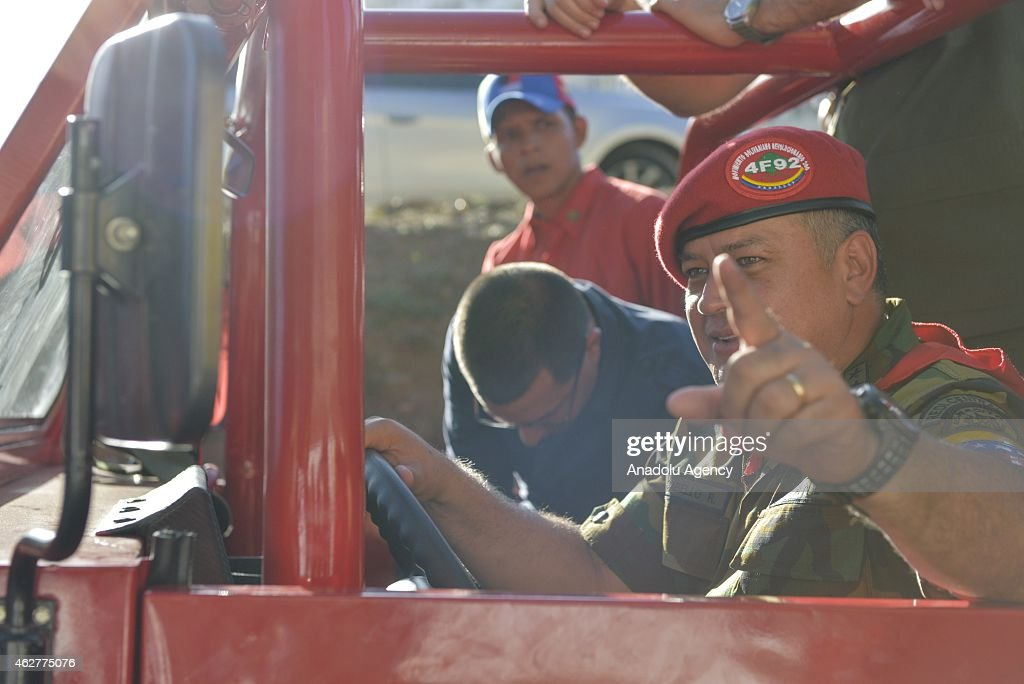 Venezuelan president of the National Assembly Diosdado Cabello drives a vehicle during a military parade for the 23rd anniversary of attempted coup...