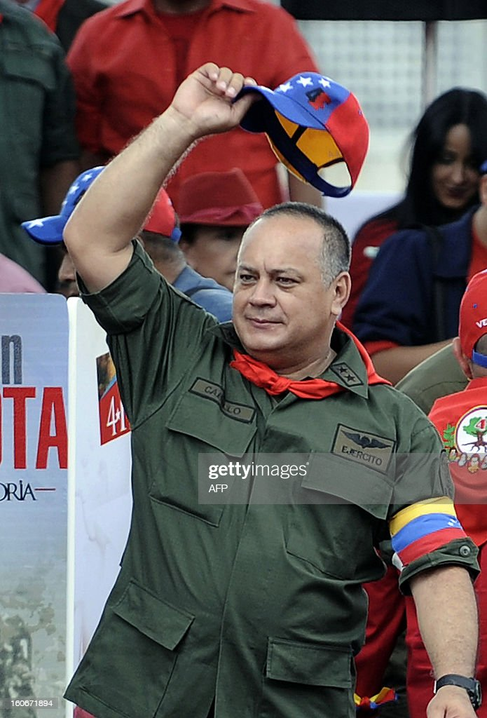 Venezuelan president of the National Assembly, Diosdado Cabello waves during the conmemoration of the 1992 failed coup led by Hugo Chavez, who was an army lieutenant colonel, against then president Carlos Andres Perez, in Caracas, on February 4, 2013. Ailing President Hugo Chavez, who had cancer surgery in December, is doing much better and recovering, Cuban leader Fidel Castro said in remarks published Monday. AFP PHOTO/Leo RAMIREZ AFP PHOTO/ Leo RAMIREZ