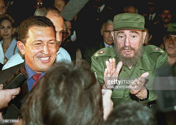 Venezuelan presidentelect Hugo Chavez flanked by Cuban leader Fidel Castro is all smiles upon his arrival at the Jose Marti airport in Havana 16...