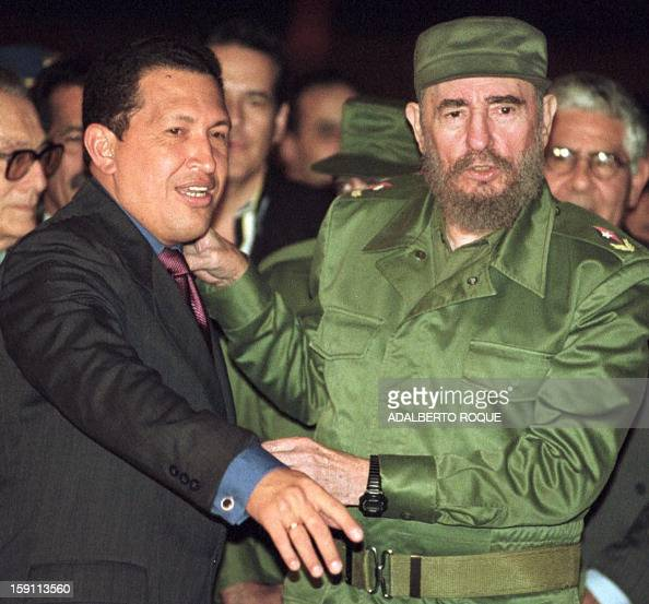 Venezuelan presidentelect Hugo Chavez is welcomed by Cuban leader Fidel Castro upon his arrival at the Jose Marti airport in Havana 16 January Chavez...