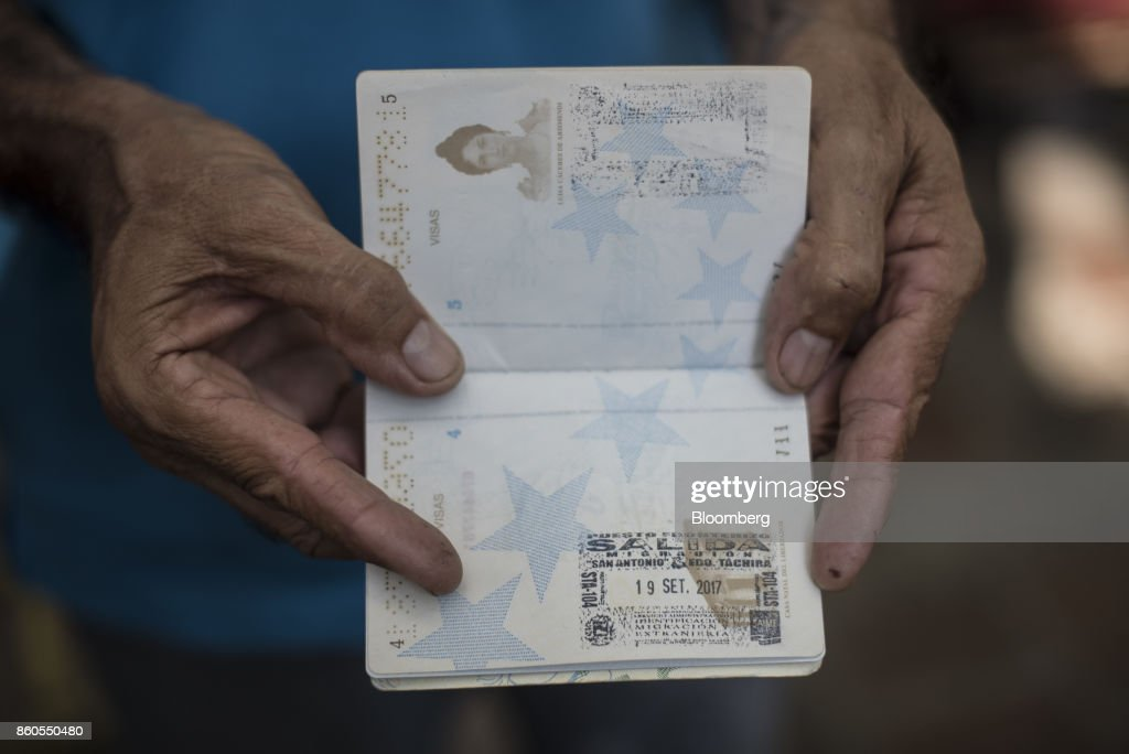 A Venezuelan resident displays a passport with an exit stamp in San Cristobal, Tachira State, Venezuela on Tuesday, Sept. 19, 2017. For weeks, Venezuelans have been flocking by the busload to San Antonio del Tachira, a border town of some 62,000 residents, fleeing as President Nicolas Maduro consolidates autocratic power. According to Colombia's migration authority, the number of foreigners entering Cucuta, the first major city across the bridge, more than doubled this summer. Photographer: Carlos Becerra/Bloomberg via Getty Images