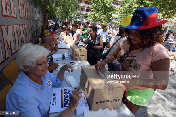 A Venezuelan resident in Barcelona casts her ballot during a symbolic plebiscite on president Maduro's project of a future constituent assembly...