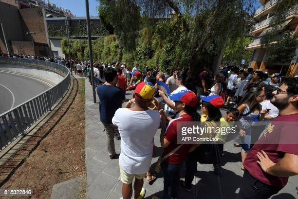 Venezuelan residents in Barcelona queue to vote during a symbolic plebiscite on president Maduro's project of a future constituent assembly called by...