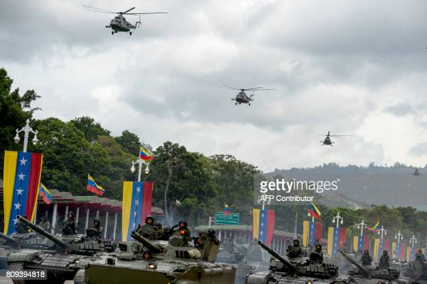 Venezuelan Russianmade Mi17 helicopters overfly a column of T72B tanks during a military parade to celebrate Venezuela's 206th anniversary of...
