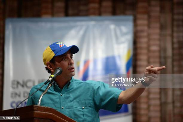 Venezuelan senior opposition leader Henrique Capriles speaks during the 'In Defence of Democracy Forum' held by the opposition in Caracas on August 6...
