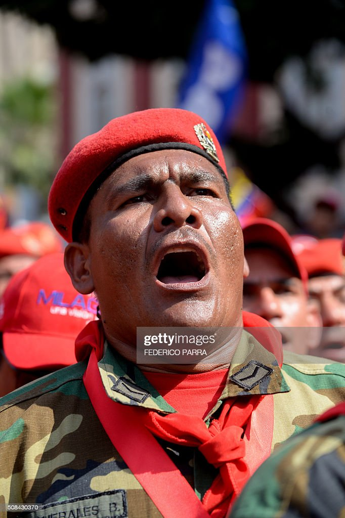 A Venezuelan soldier sings the national anthem during a ceremony to commemorate the 24th anniversary of former Venezuelan President Hugo Chavez's...