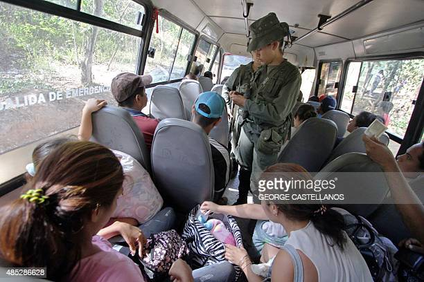 Venezuelan soldiers check the passengers of a bus at a checkpoint in San Antonio de Tachira Venezuela near the border with Colombia on August 26 2015...