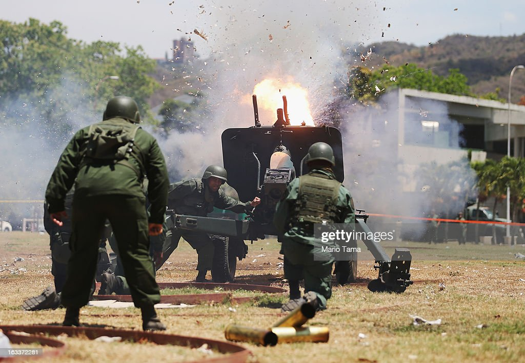 Venezuelan soldiers fire weaponry during a salute at the start of the funeral for Venezuelan President Hugo Chavez outside the Military Academy on March 8, 2013 in Caracas, Venezuela. Countless Venezuelans have paid their last respects to Chavez and more than 30 heads of state were expected to attend the funeral today.