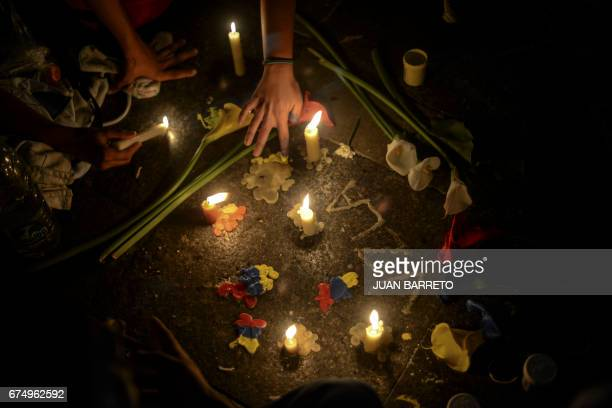 TOPSHOT Venezuelan students participate in a march paying tribute to fellow student Juan Pablo Pernalete killed on April 26 by the impact of a gas...