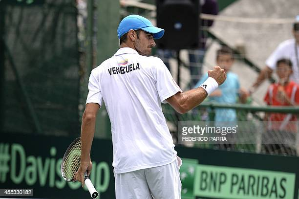 Venezuelan tennis player Ricardo Rodríguez celebrates after beating Uruguay's Martín Cuevas during their Davis Cup American Zone Group I singles...