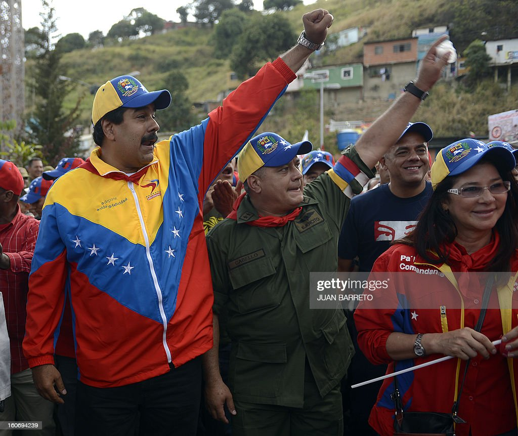 Venezuelan Vice President Nicolas Maduro (L) and Venezuelan president of the National Assembly, Diosdado Cabello (C) walk during the conmemoration of the 1992 failed coup led by Chavez, who was an army lieutenant colonel, against then president Carlos Andres Perez, in Caracas, on February 4, 2013. Ailing President Hugo Chavez, who had cancer surgery in December, is doing much better and recovering, Cuban leader Fidel Castro said in remarks published Monday. AFP PHOTO/JUAN BARRETO